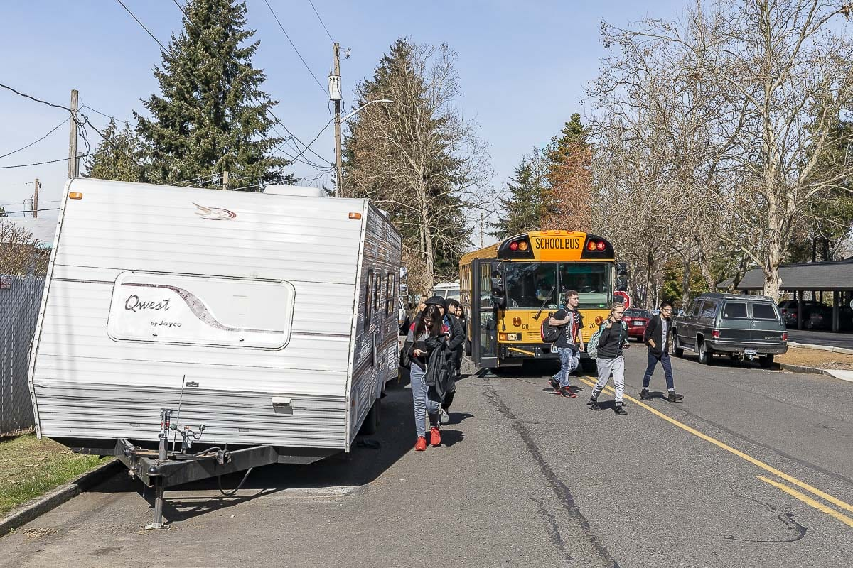 Students get off a bus near RVs parked along NE 13th Avenue in Hazel Dell. Photo by Mike Schultz