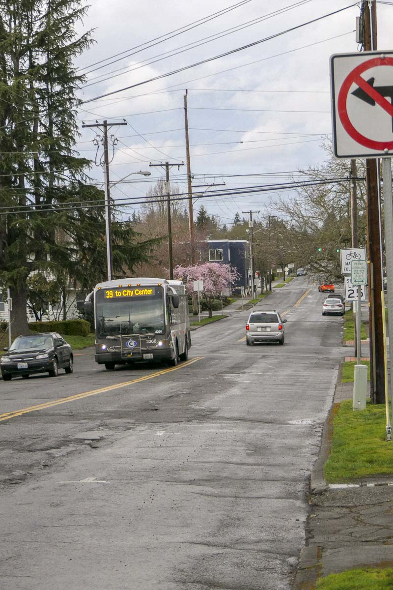 A C-TRAN bus is shown here on Columbia Street, where parking spots were due to be eliminated as part of a plan to add bike lanes along the corridor through downtown Vancouver. Photo by Chris Brown