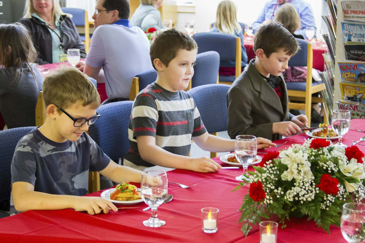 During a class lesson before the event, students learned how to use an entire set of silverware in preparation for enjoying a meal with multiple courses. Photo courtesy of Woodland School District