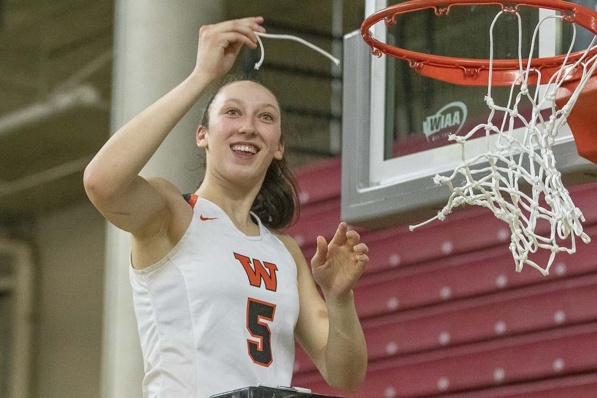 Beyonce Bea gets a piece of the net after helping Washougal to a state championship. Photo by Mike Schultz