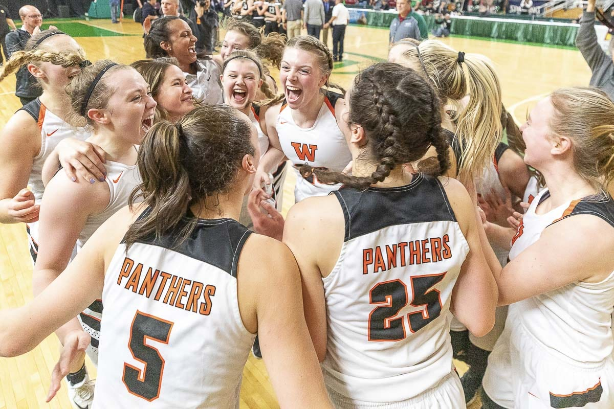 The Washougal Panthers completed a 22-4 season by winning their final 16 games to claim their first girls basketball state championship. Photo by Mike Schultz
