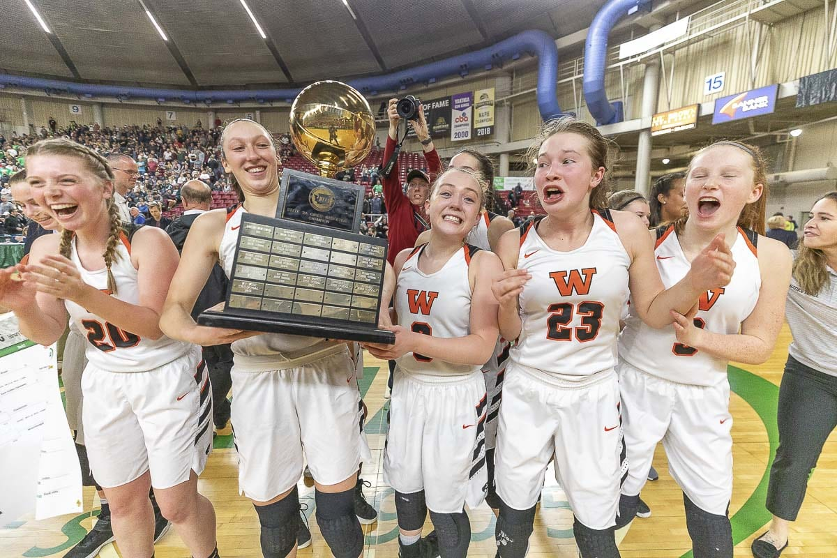 The Washougal Panthers are the Class 2A girls basketball state champions. Photo by Mike Schultz
