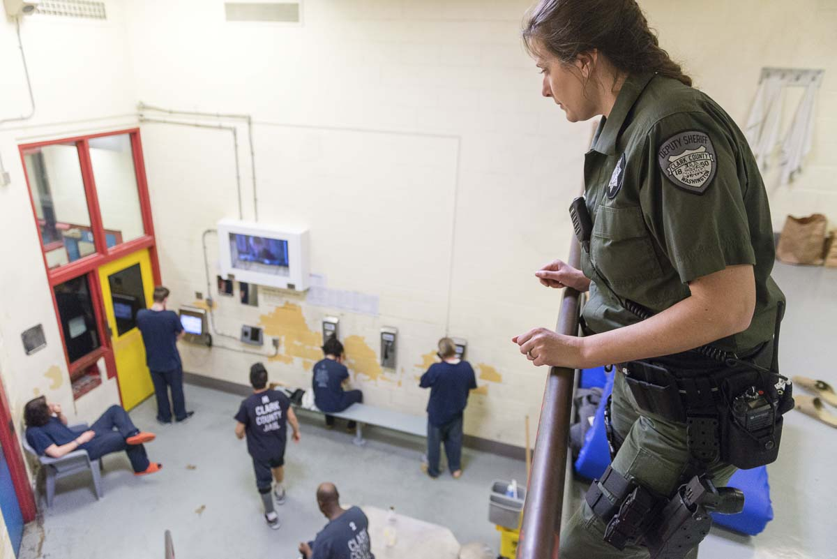 A Clark County Corrections Deputy watches over inmates in the jail's common area. Photo courtesy Clark County Sheriff's Office