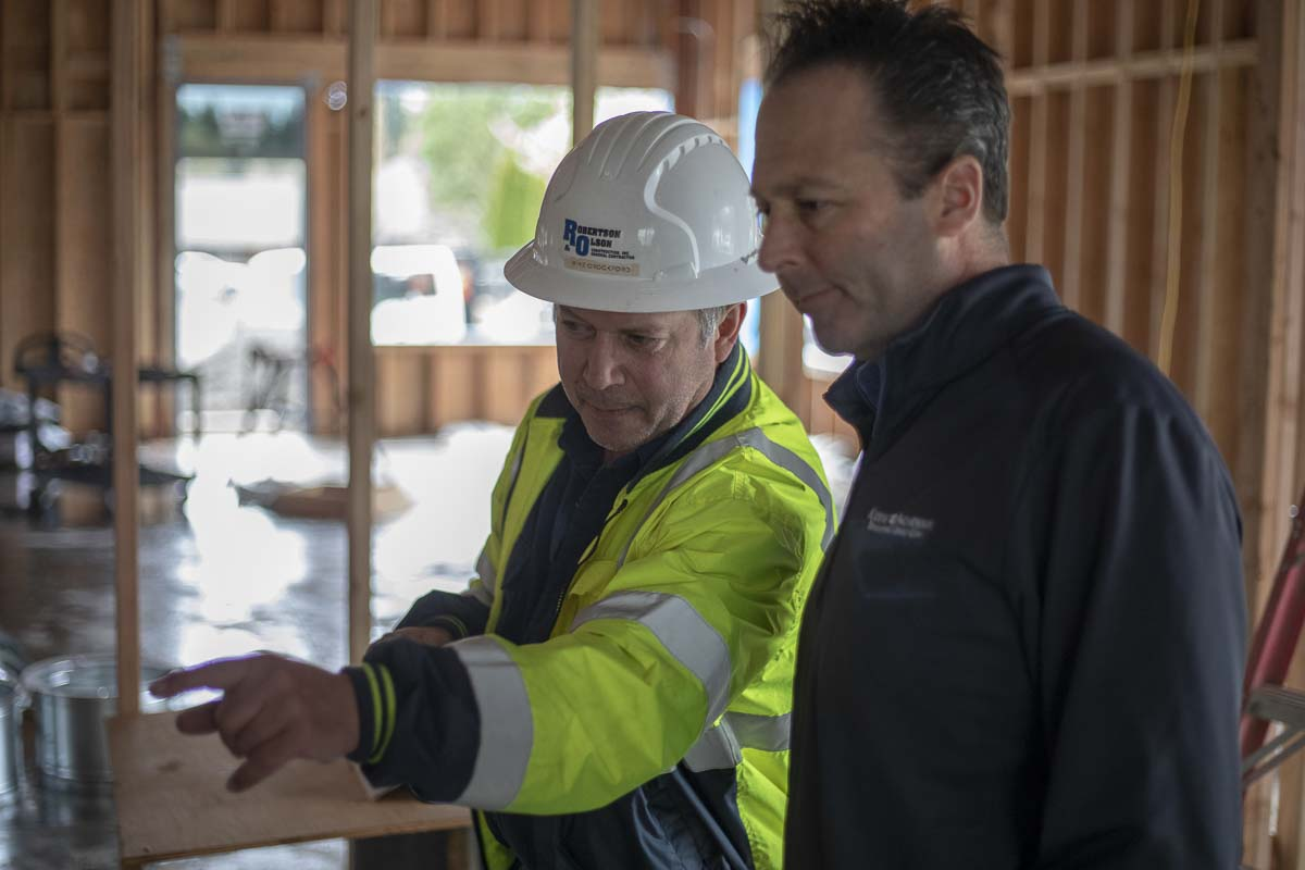 Mike Crockford, (left), and John Schwartz, (right), look over construction progress of the new Kiddie Academy facility in Salmon Creek. Crockford is the manager of the site and the company doing the project. Photo by Jacob Granneman