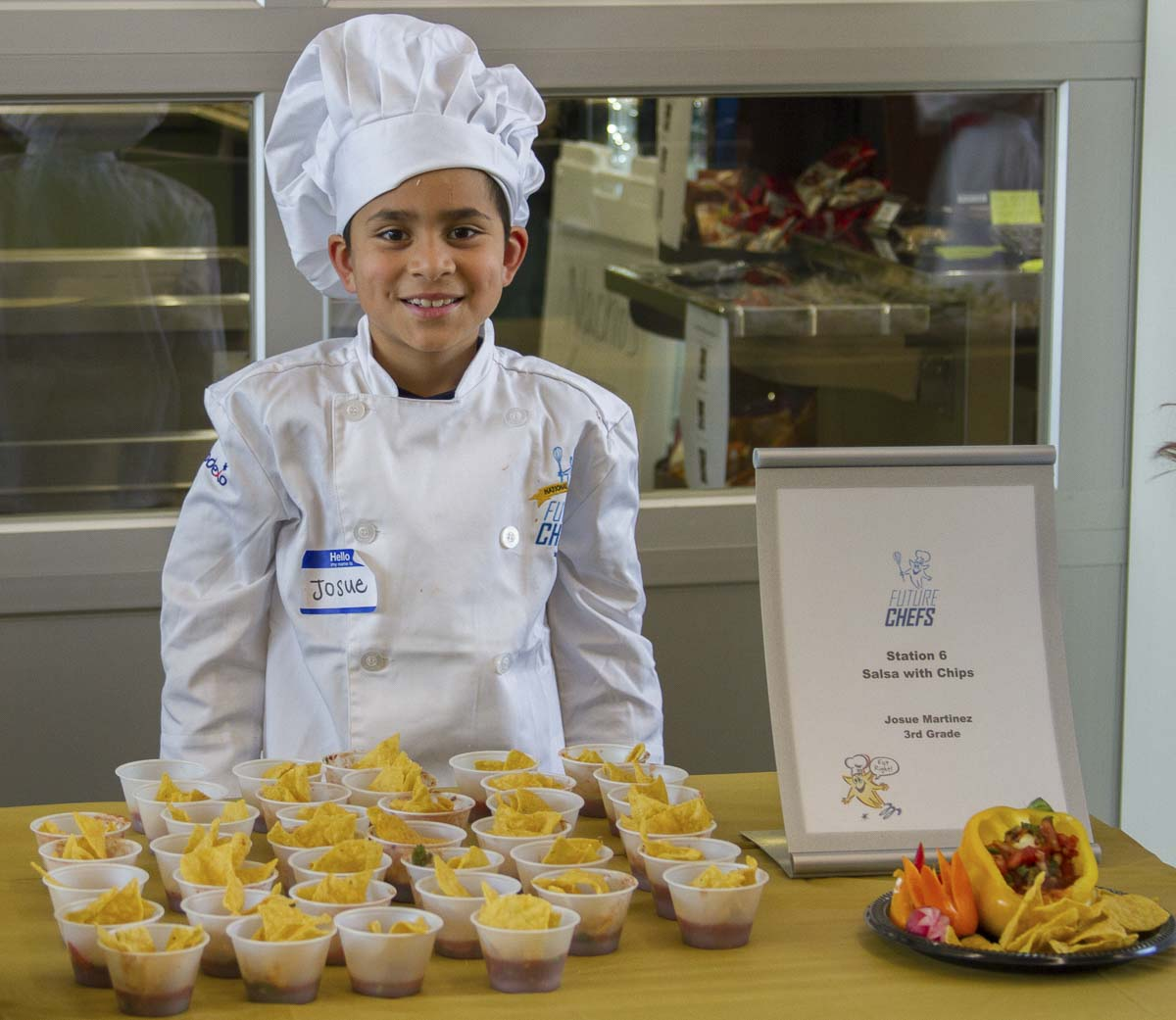 Student chefs prepare enough of their recipe to be enjoyed by everyone who attends the event. Photo courtesy of Woodland School District