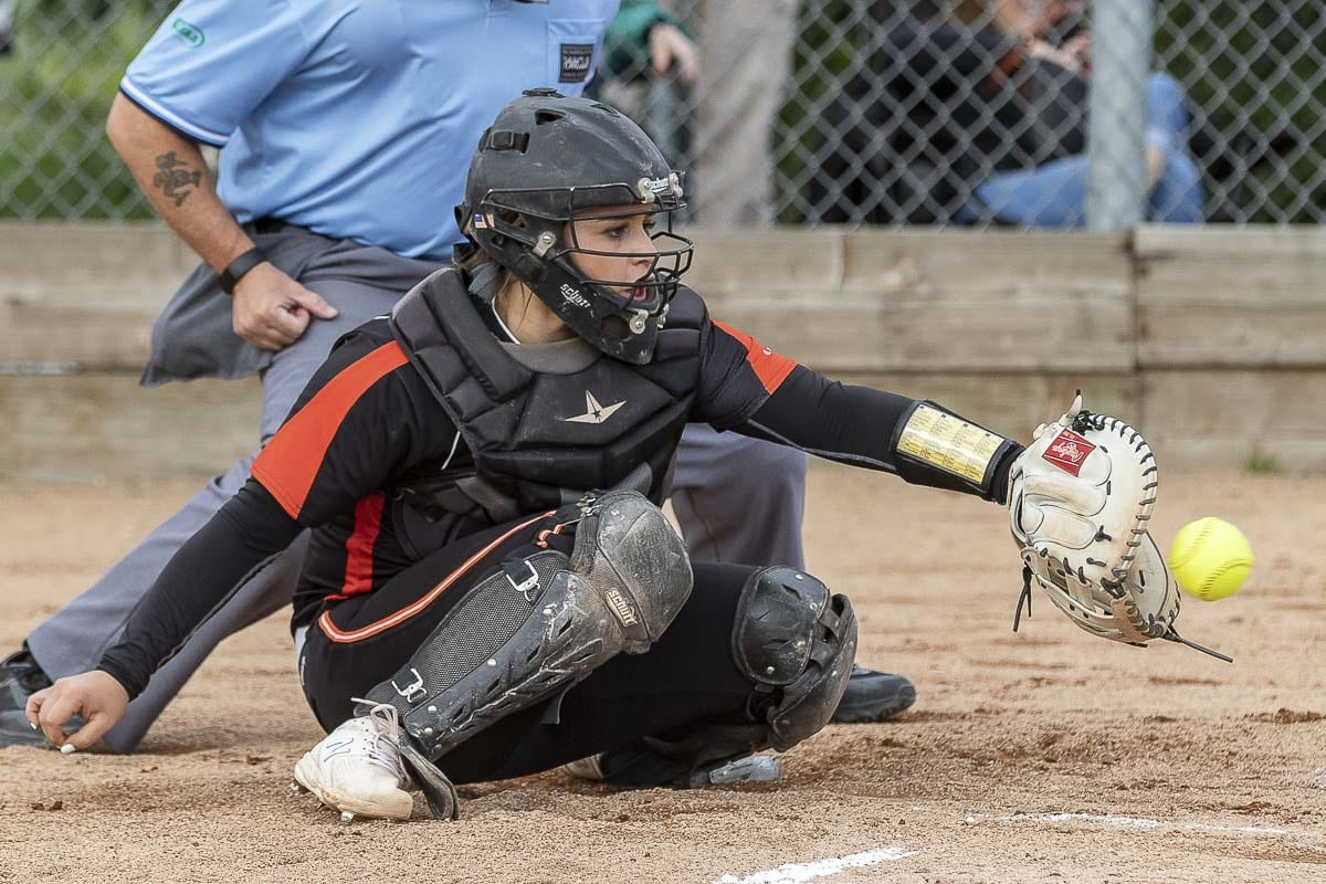 Grace Stillman plays the demanding position of catcher for the Battle Ground Tigers, and she is one of the team's best hitters. Photo by Mike Schultz