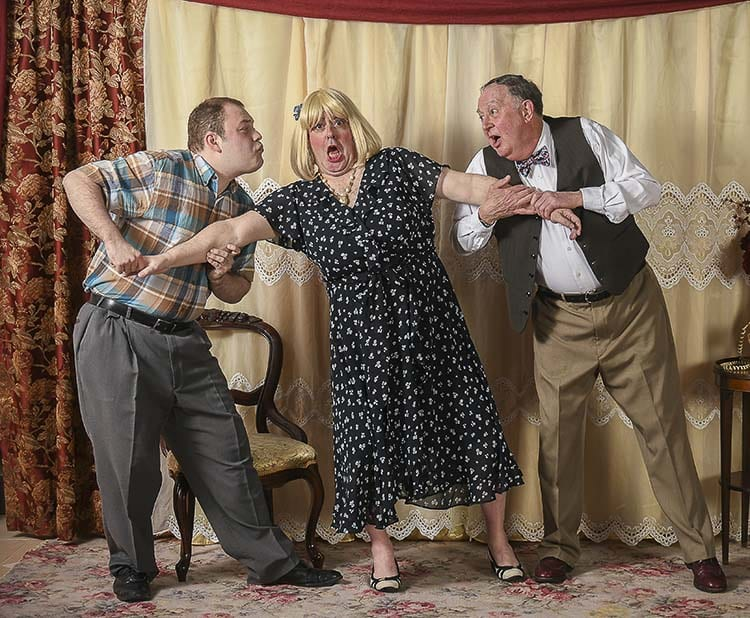 Mistaken identities, love and laughter abound in Leading Ladies at Love Street Playhouse this April 26 through May 12. When Butch (left, played by Henry Lorch of Vancouver) and Doc (right, played by Tom Golik of Woodland), fight for the affection of Stephanie (center, played by Craig Hoehne of Longview) the chase for her (or his??) heart begins. Photo courtesy of Mike Patnode