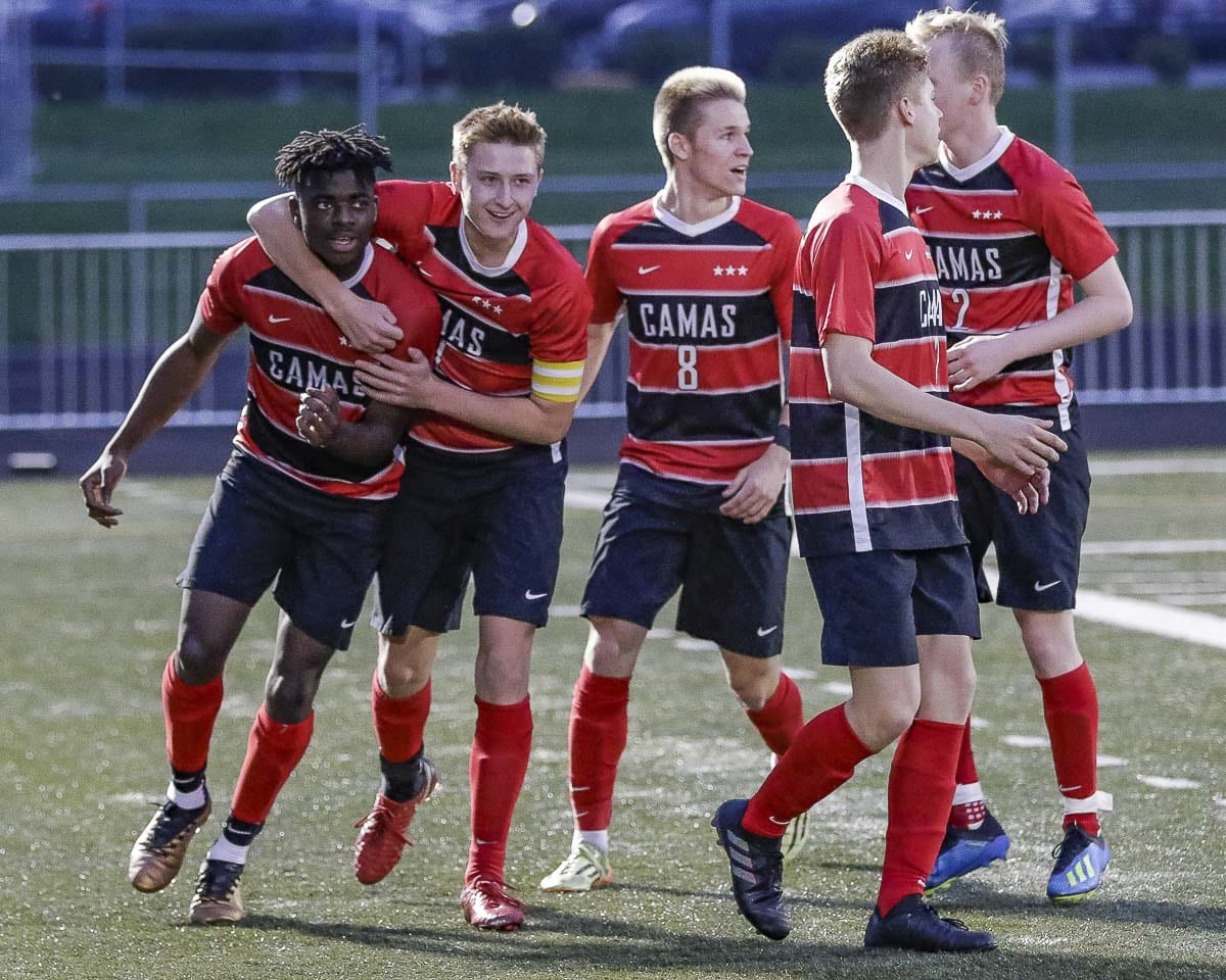 The Camas Papermakers celebrate a goal in a match last week. Daudra Woodruff (No. 9) scored. Photo by Mike Schultz