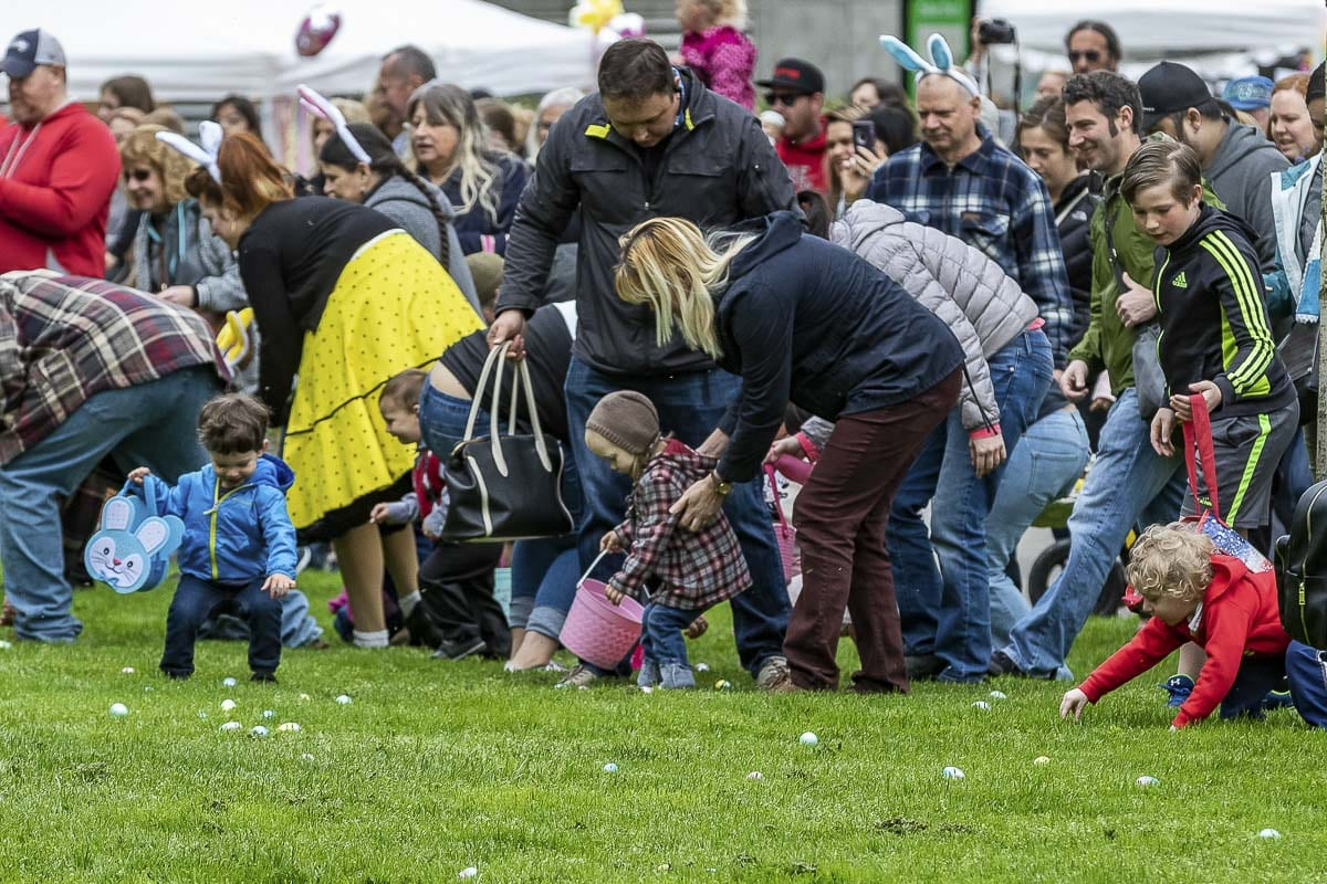 Some of the little ones who participated in the Easter Egg Hunt at Esther Short Park in Vancouver Saturday needed a little help from their parents and adults. Photo by Mike Schultz
