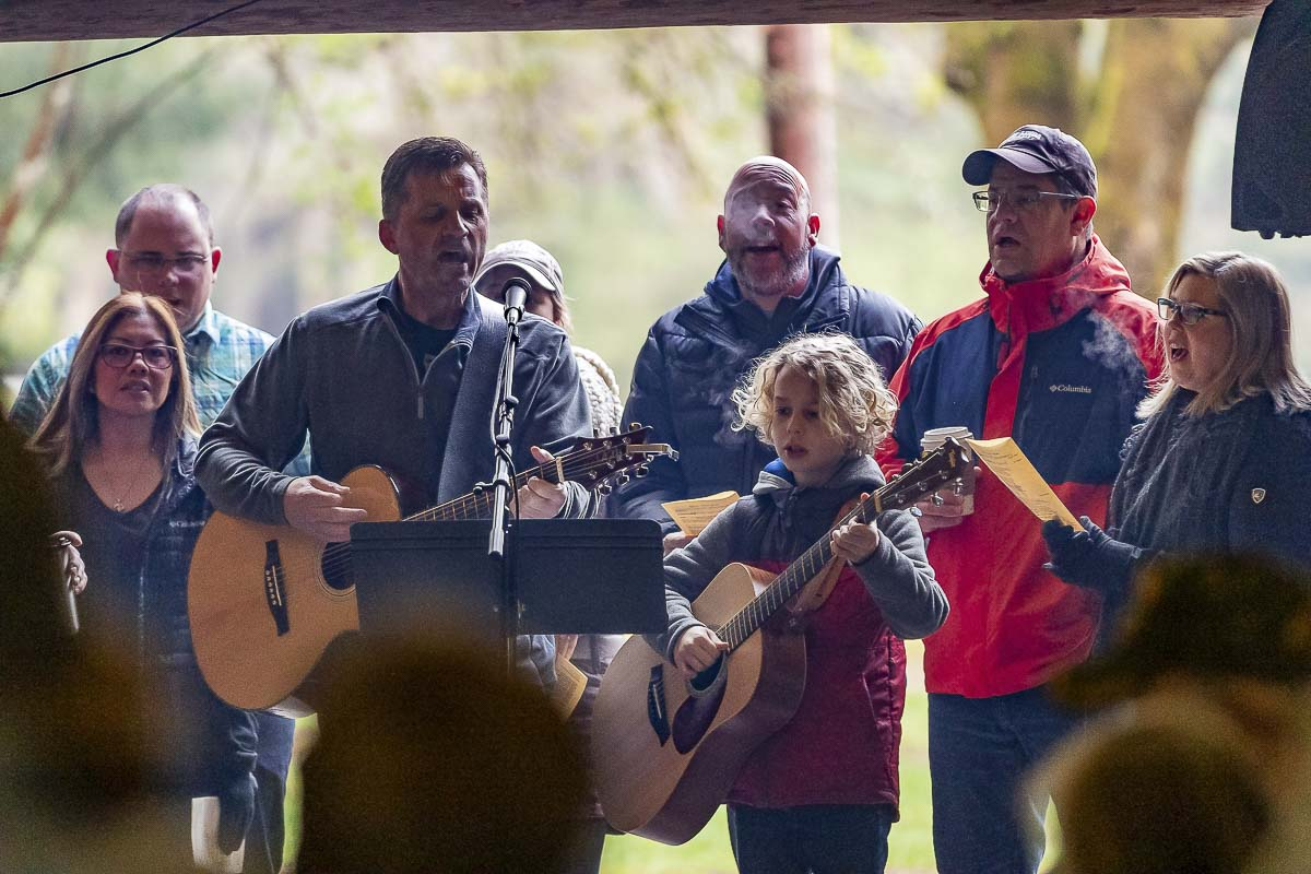 Members of a worship team lead attendees in song Sunday at the annual Easter Sunrise Community Worship Service at Lewisville Park in Battle Ground. Photo by Mike Schultz