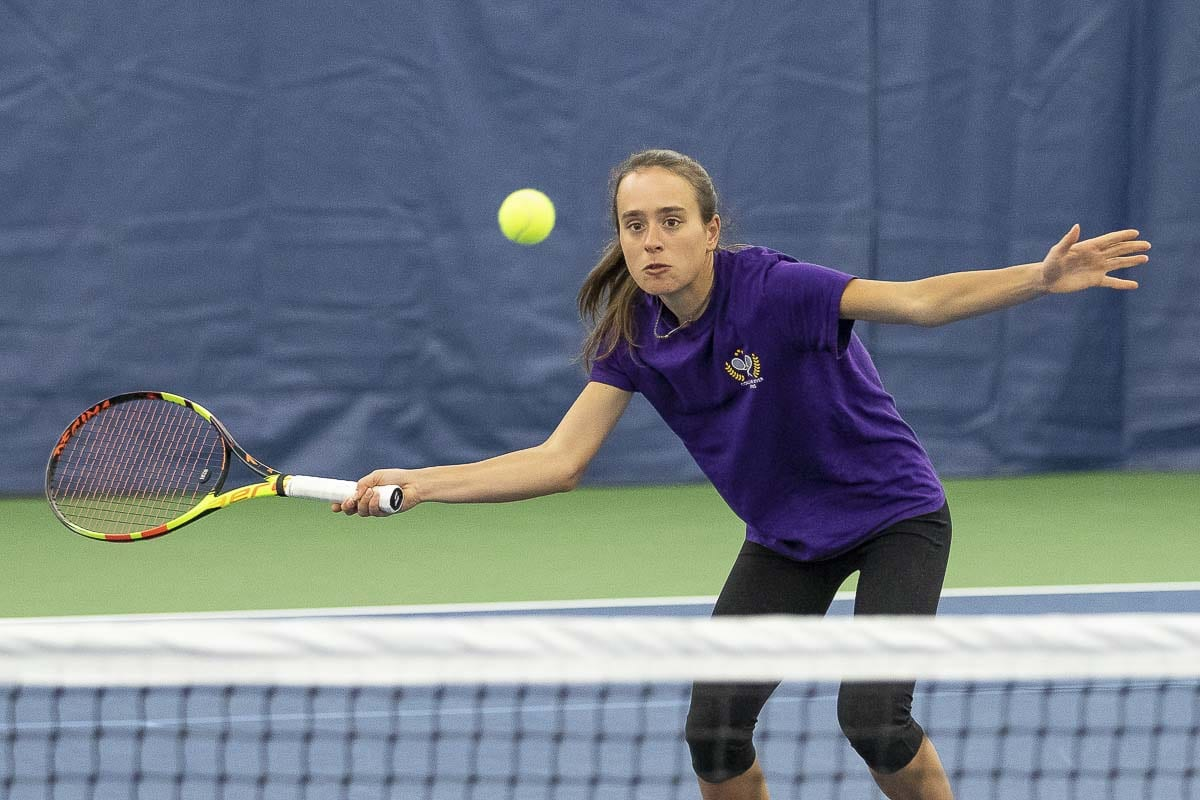 Faith Grisham of Columbia River says she not only loves playing tennis, she loves practice, too. A senior, she is among the favorites to win a state title this spring. Photo by Mike Schultz
