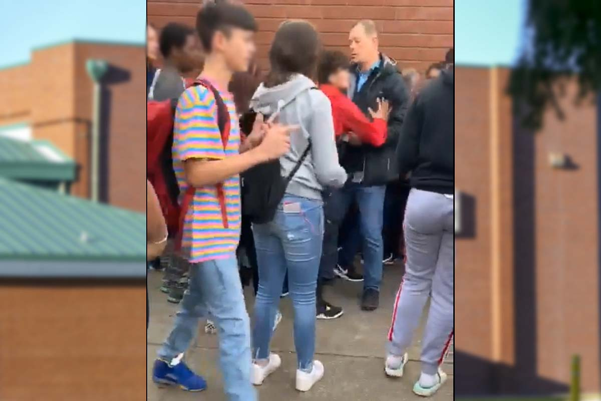 Another school employee is shoved by a student outside the gym at Gaiser Middle School as the incident escalated further. Photo courtesy of Vancouver School District