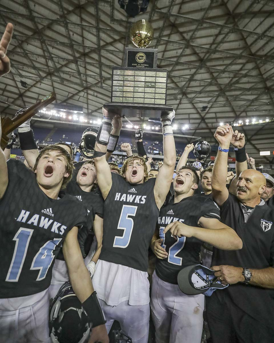 The Hockinson Hawks celebrated their second consecutive Class 2A state football title in December. Hockinson is one of five schools from the 2A Greater St. Helens League that has won state titles in the past 12 months. Photo by Mike Schultz