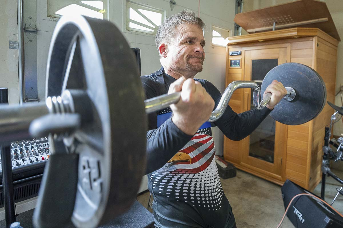 Karl Johnson dedicated himself to getting back in shape a year ago after a family crisis turned into a mental health scare. He started running, eating right, and then got the idea to return to the wrestling mat. That meant getting in even better shape. Photo by Mike Schultz