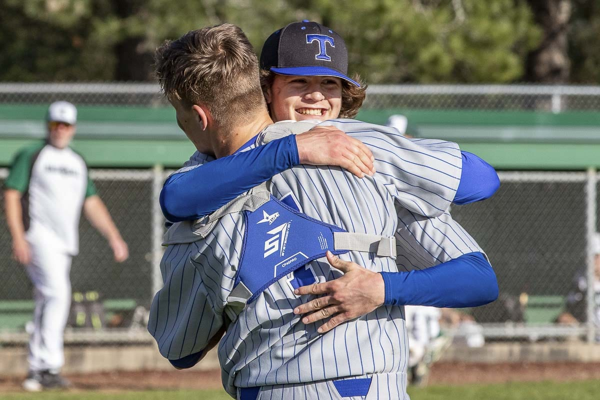 Mountain View pitcher Trevor Milton and catcher Riley McCarthy embrace after another Thunder victory. Photo by Mike Schultz