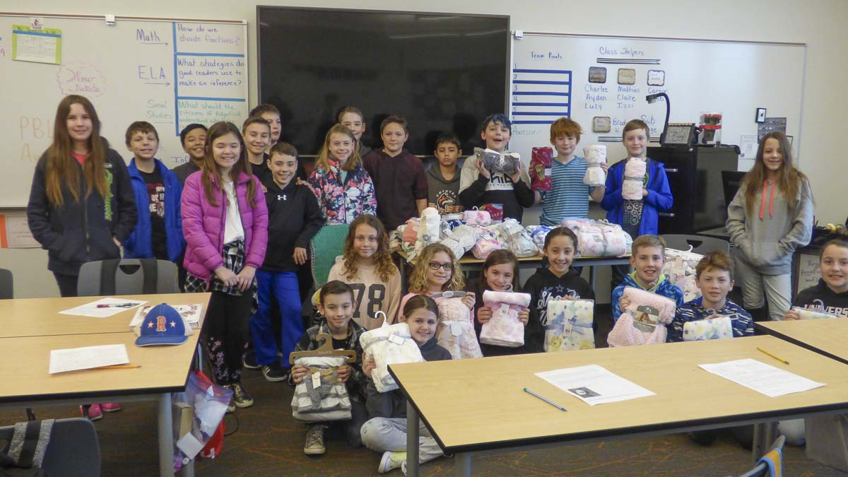 "Students in Laura Gosnell's fifth grade class at Sunset Ridge Intermediate School are shown here with the baby blankets they collected for donation to Legacy Salmon Creek Hospital and ""Babies In Need."" Photo courtesy of Ridgefield School District"