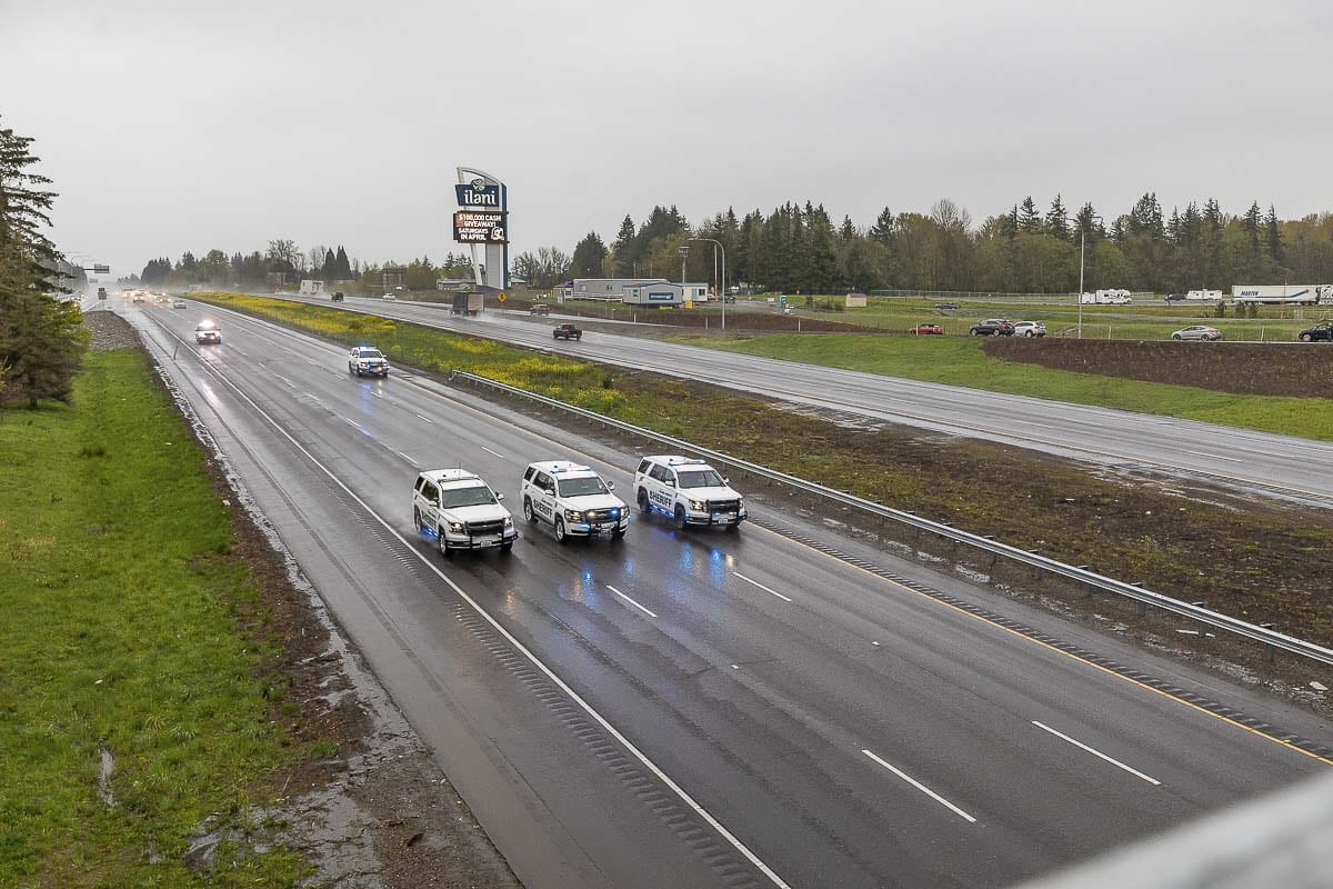 Clark County Sheriff's vehicles lead a procession from Vancouver to Kalama for fallen Cowlitz County Deputy Justin DeRosier. Photo by Mike Schultz