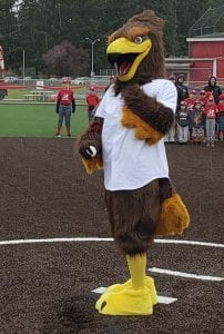 Rally the Raptor made a first pitch at Alcoa Little League's opening ceremony Saturday. Photo by Paul Valencia