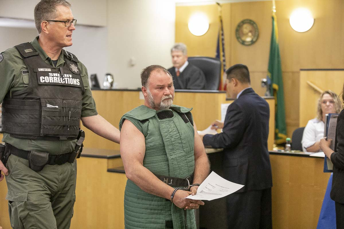 Randy John Schmidt is led out of a Clark County courtroom after being arraigned for the murder of Michael Chad Holmes of Camas. Photo by Mike Schultz