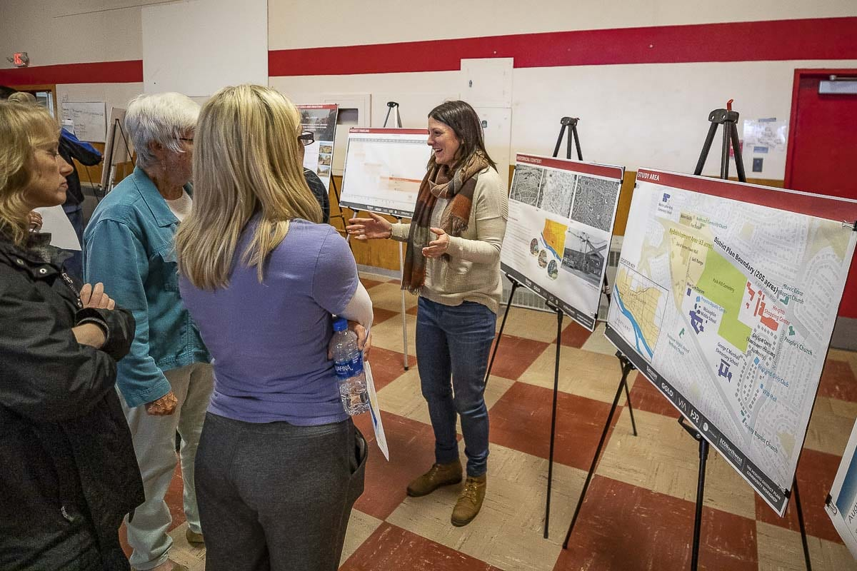Rebecca Kennedy, long-range planning manager for the city of Vancouver, talks with residents at an open house for The Heights Redevelopment Draft Comprehensive Plan. Photo by Mike Schultz
