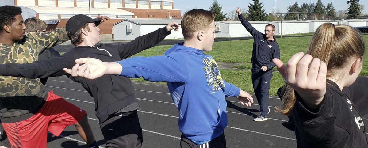 Scott Halley shares a few techniques with athletes Saturday at a throwers clinic. Athletes from several high schools got expert advice in javelin, discus, and shot put at Heritage High School. Photo by Paul Valencia
