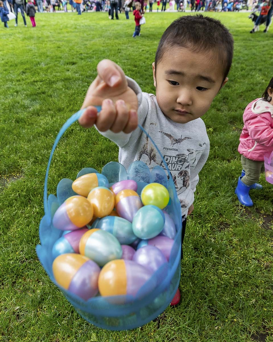 Shota Stumpf shows off the fruits of his efforts at the Easter Egg Hunt held Sunday at Esther Short Park in Vancouver. Photo by Mike Schultz