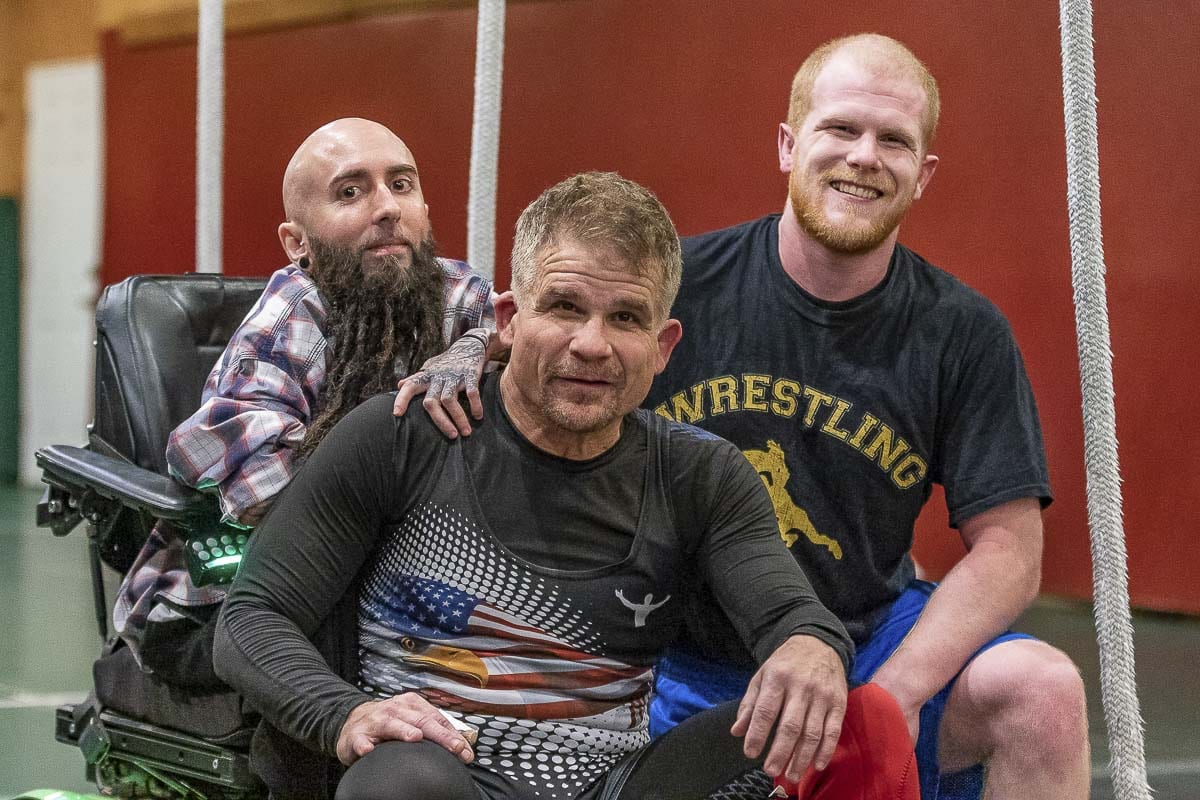 Stephen Johnson (left) and Jake Johnson (right) are coaching their dad Karl Johnson in his return to wrestling at the age of 55. Photo by Mike Schultz