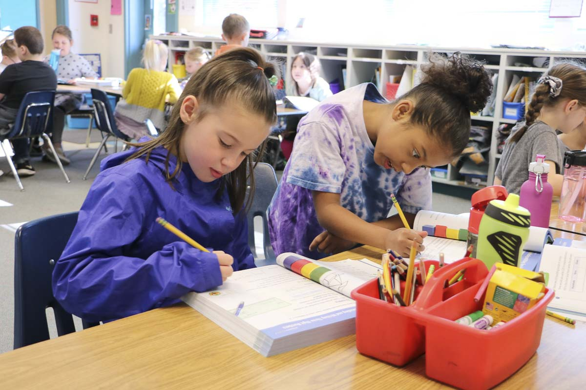 Yacolt Primary 2nd graders work on math problems from a textbook being considered by the Battle Ground School District. Photo courtesy of the Battle Ground School District