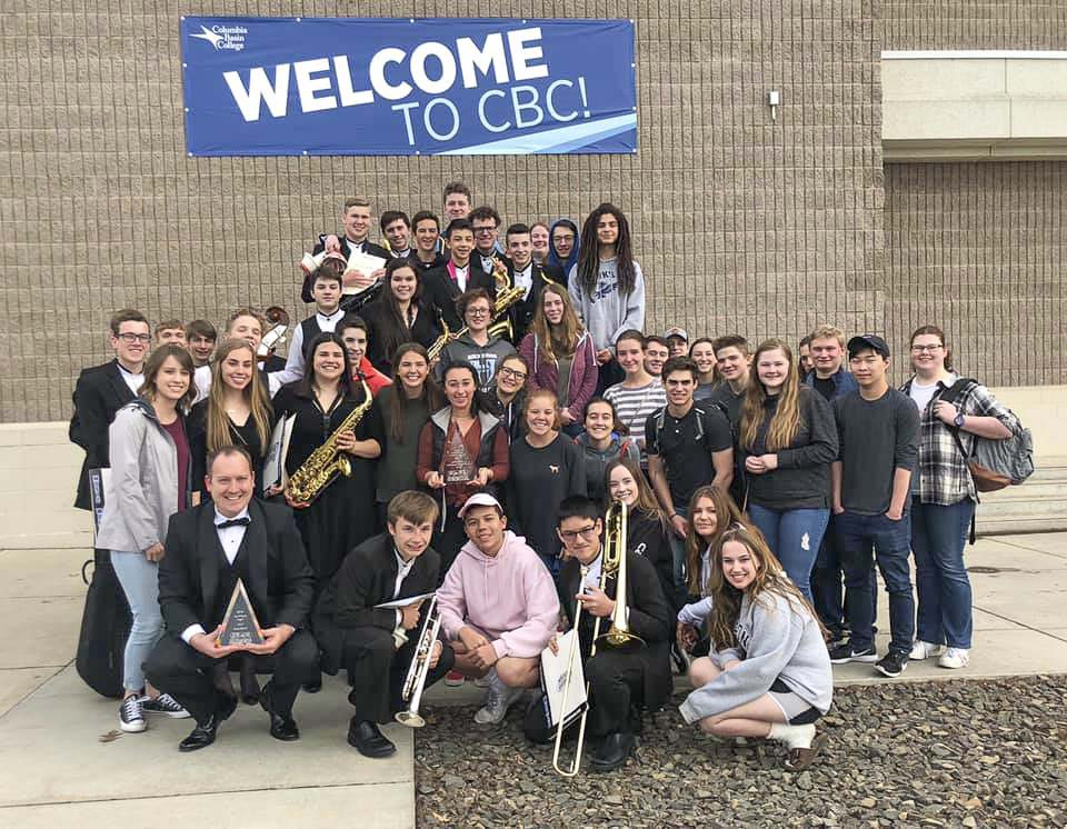 Hockinson High School band students and Director Corey McEnry hold trophies at Columbia Basin College Band Festival. Photo courtesy of Hockinson School District