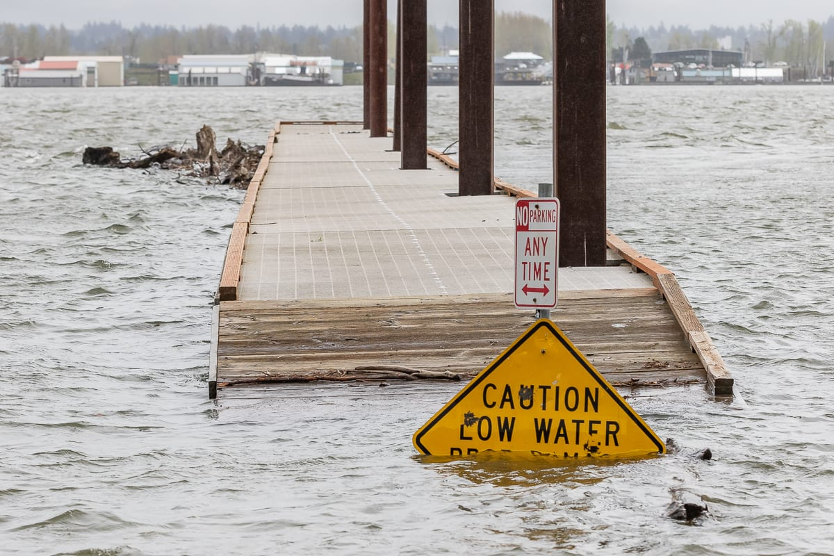 A Low Water sign sits half submerged at the Marine Park dock in Vancouver. Photo by Mike Schultz