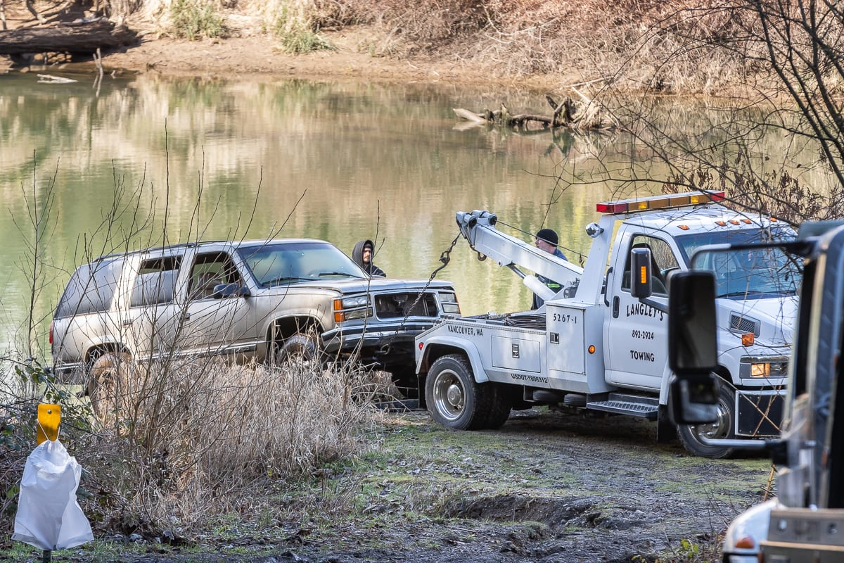 A vehicle linked to the disappearance and apparent murder of a Camas man is pulled from the Lewis River in early March. Photo by Mike Schultz