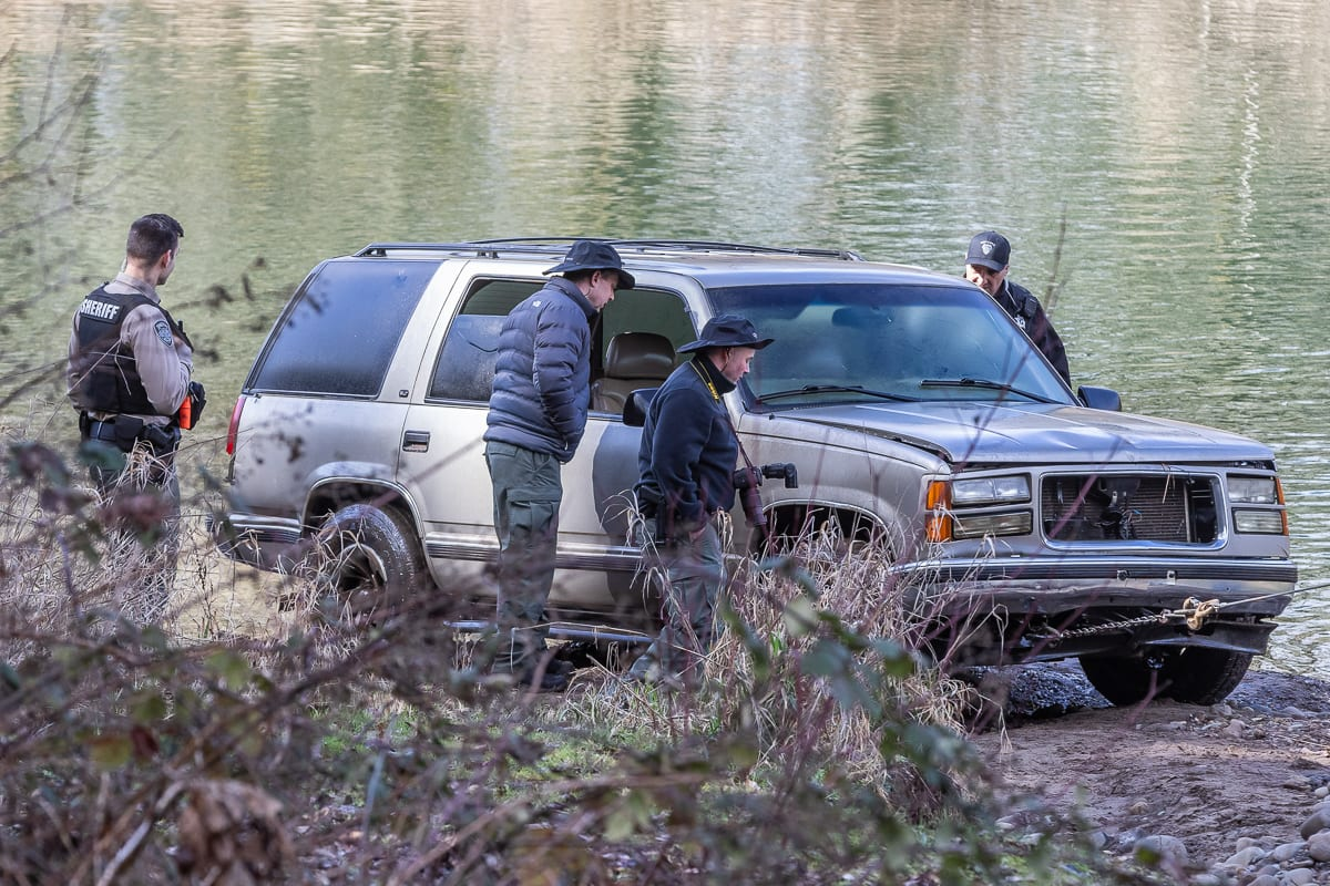 Members of the Clark County Major Crimes team investigate a vehicle recovered from the Lewis River, linked to the disappearance of a Camas man. Photo by Mike Schultz