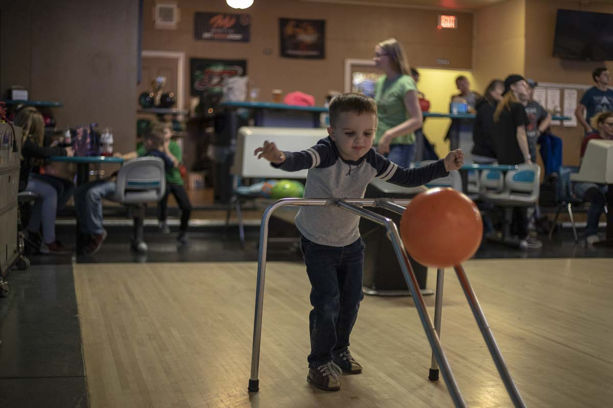 George Veach is seen here using a bowling ramp to score a spare at Tiger Bowl with his mom Amber. Photo by Jacob Granneman