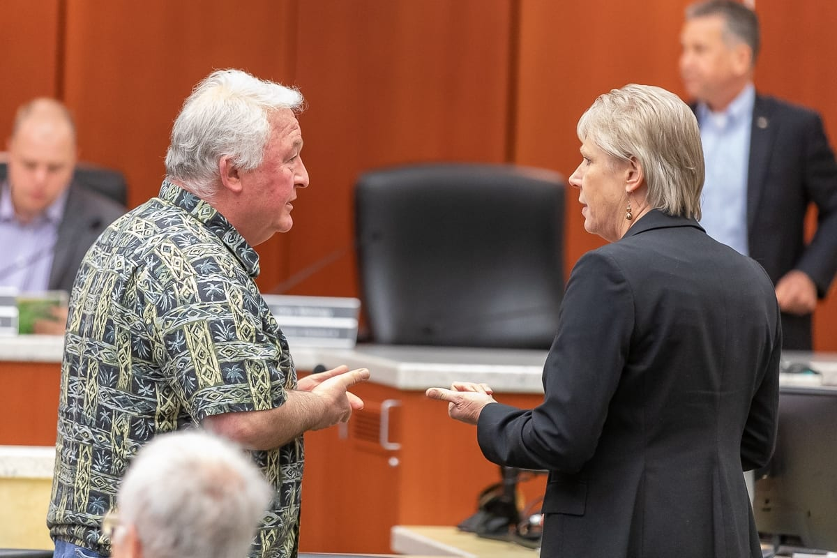 Jim Mullen, owner of The Herbery, talks with Councilor Julie Olson following a Cannabis Work Session for county council. Photo by Mike Schultz