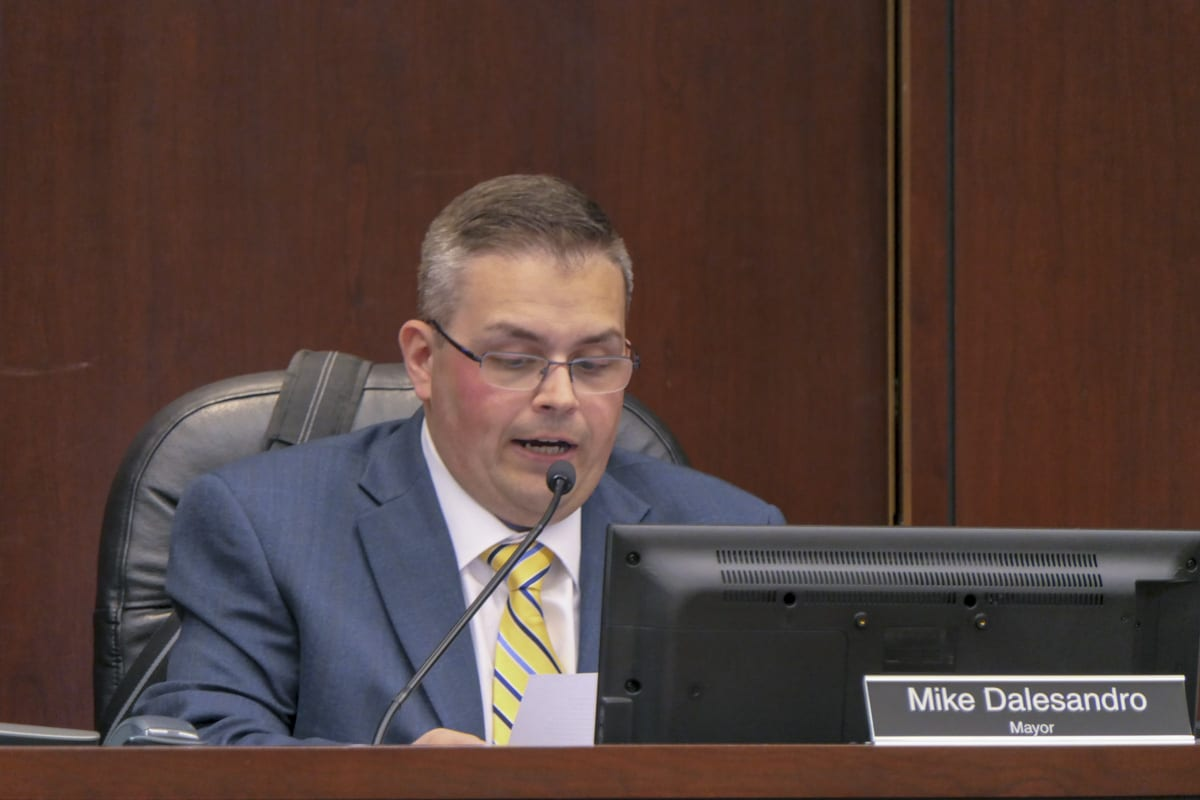 Battle Ground Mayor Mike Dalesandro reads a statement on I-1639 at Monday's council meeting. Photo by Chris Brown