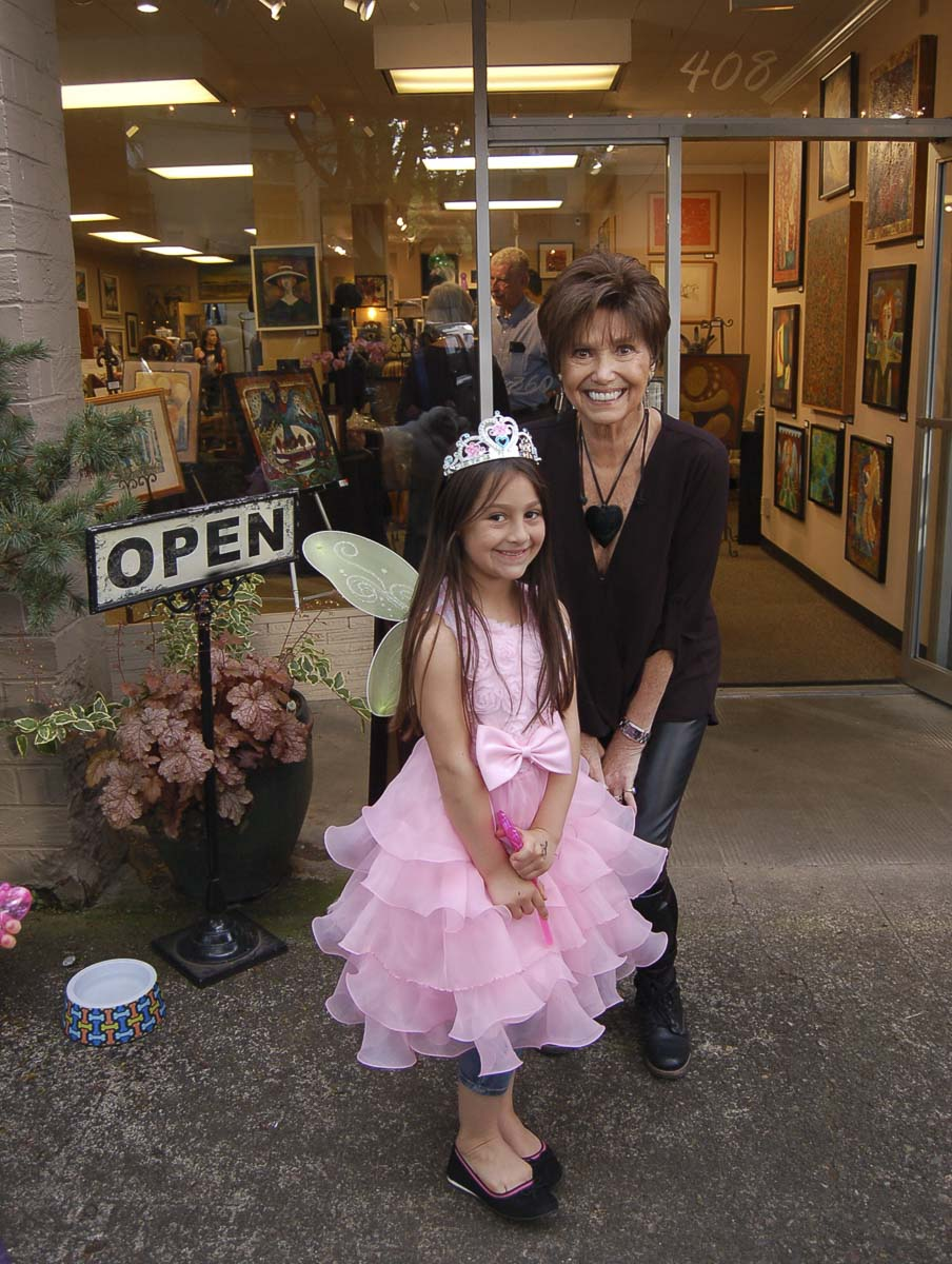 Marquita Call, of Camas Gallery, is shown here with a fairy friend at the May 2018 First Friday event in downtown Camas. Photo courtesy of the Downtown Camas Association