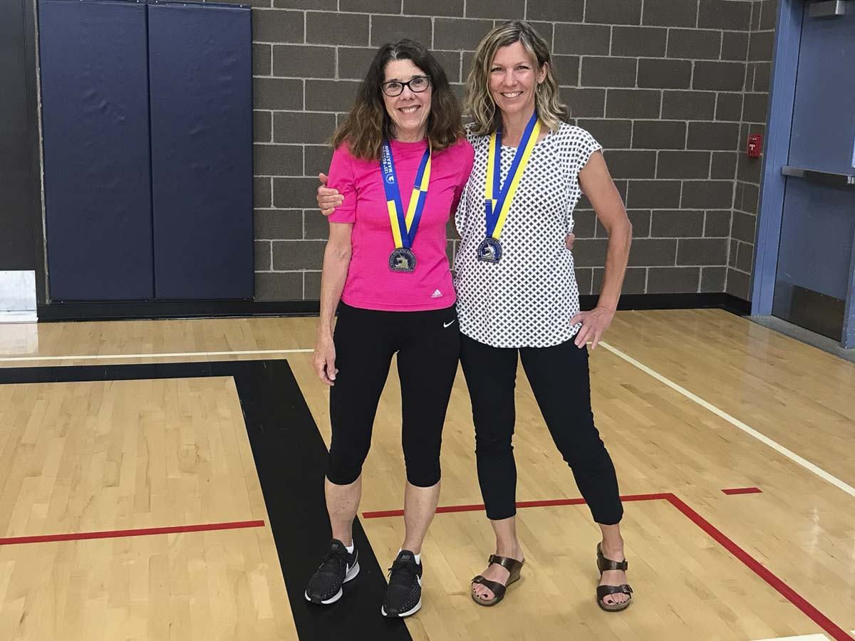 Captain Strong Primary physical education teacher Sandee Myers (left) and Chief Umtuch Middle School counselor Krista Roadifer (right) are shown here with their medals received after successfully completing the 123rd Annual Boston Marathon on April 15. Photo courtesy of Battle Ground School District