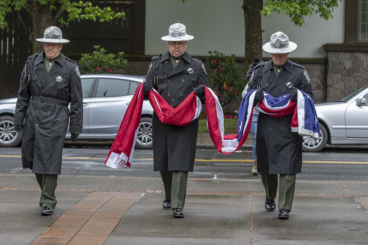 Members of the Portland Highland Guard and Multi-Agency Color Guard bring forth the American flag at the 2019 Clark County Law Enforcement Memorial Ceremony in Vancouver. Photo by Mike Schultz