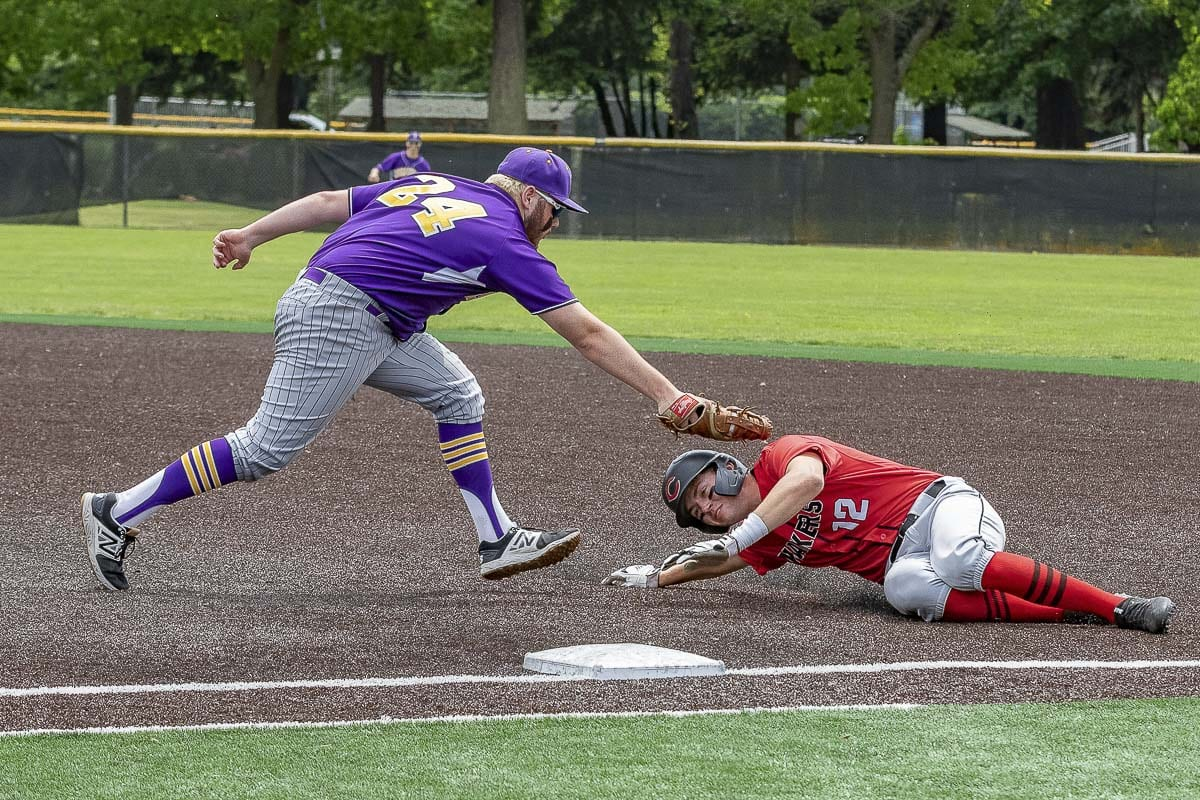 Shane Jamison tries to get under the tag during Camas' baseball game against Issaquah. Later, Jamison got Camas' lone RBI of the game. Issaquah beat Camas 5-1. Photo by Mike Schultz