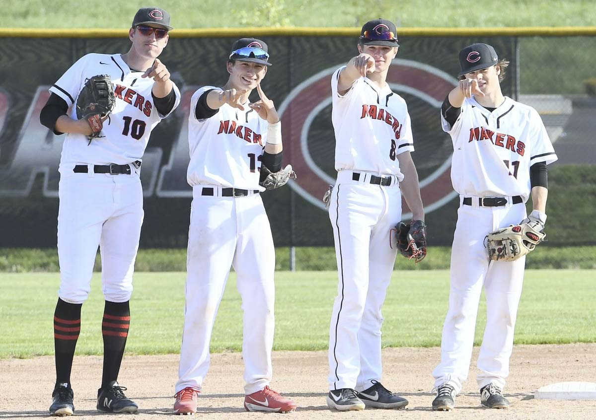 The Camas Papermakers will see you at the Class 4A state baseball tournament. From left to right, Jacob Trupp, Quinten Sawyer, Jake Blair, and Kobly Broadbent having a little fun with the camera at a game earlier this season. The Papermakers beat Auburn Mountainview on Tuesday to clinch a berth to state. Photo by Kris Cavin