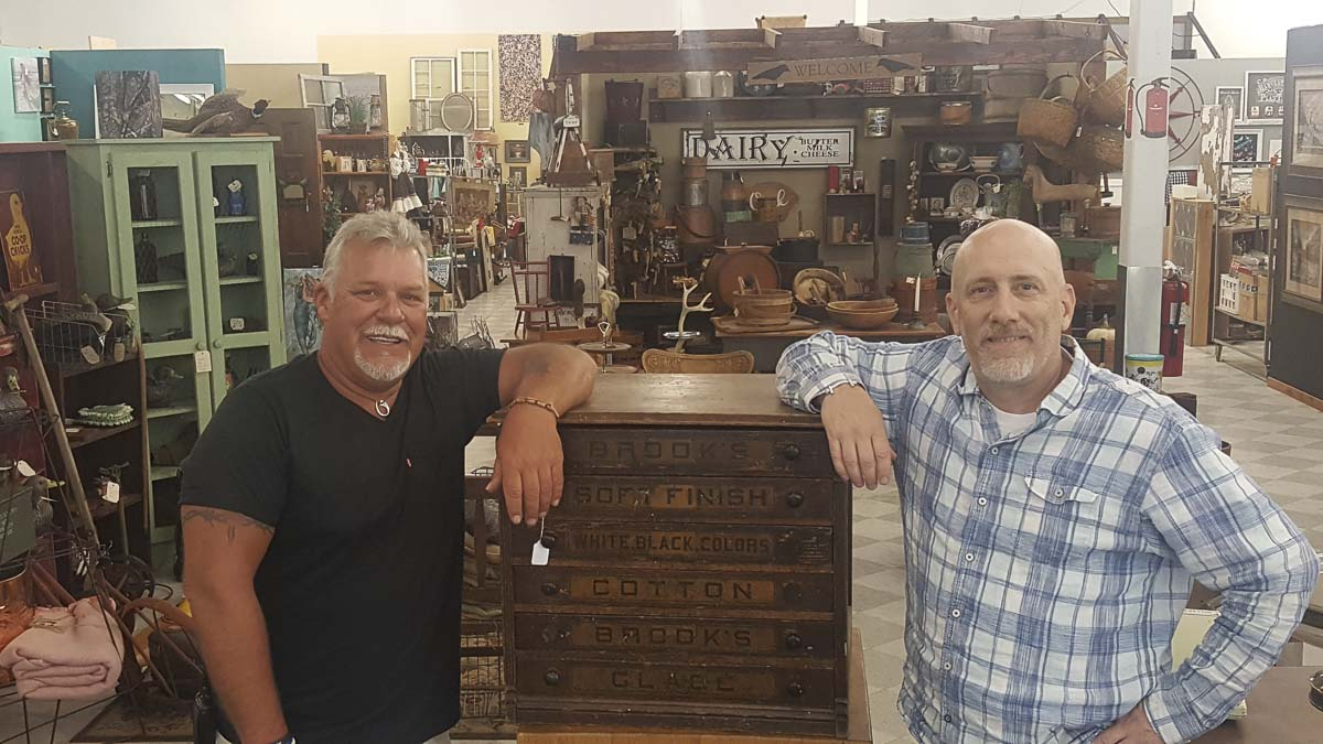 Co-owners Chris Lutz and Scott Wyckoff are offering 20 percent off their entire inventory to celebrate the grand opening of Reliques Marketplace in Vancouver Plaza near the Vancouver Mall. Photo courtesy of Reliques Marketplace