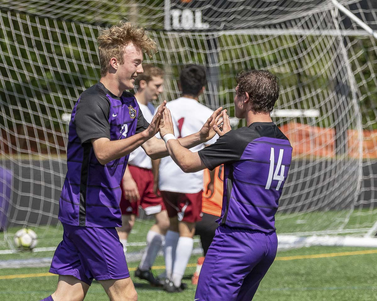 Ryan Brown takes the shot, sees the ball go into the net, then celebrates with teammate Jake Connop during Columbia River's win over W.F. West over the weekend in the opening round of the Class 2A District 4 boys soccer tournament. Photos by Mike Schultz