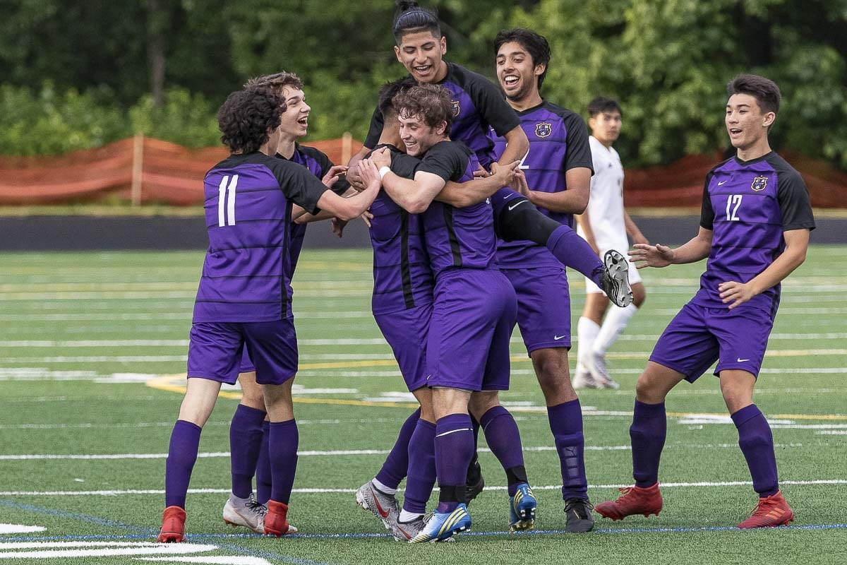 The Columbia River Chieftains, shown here earlier in their playoff run this season, hope to celebrate one more win Saturday in the Class 2A state championship match. Photo by Mike Schultz