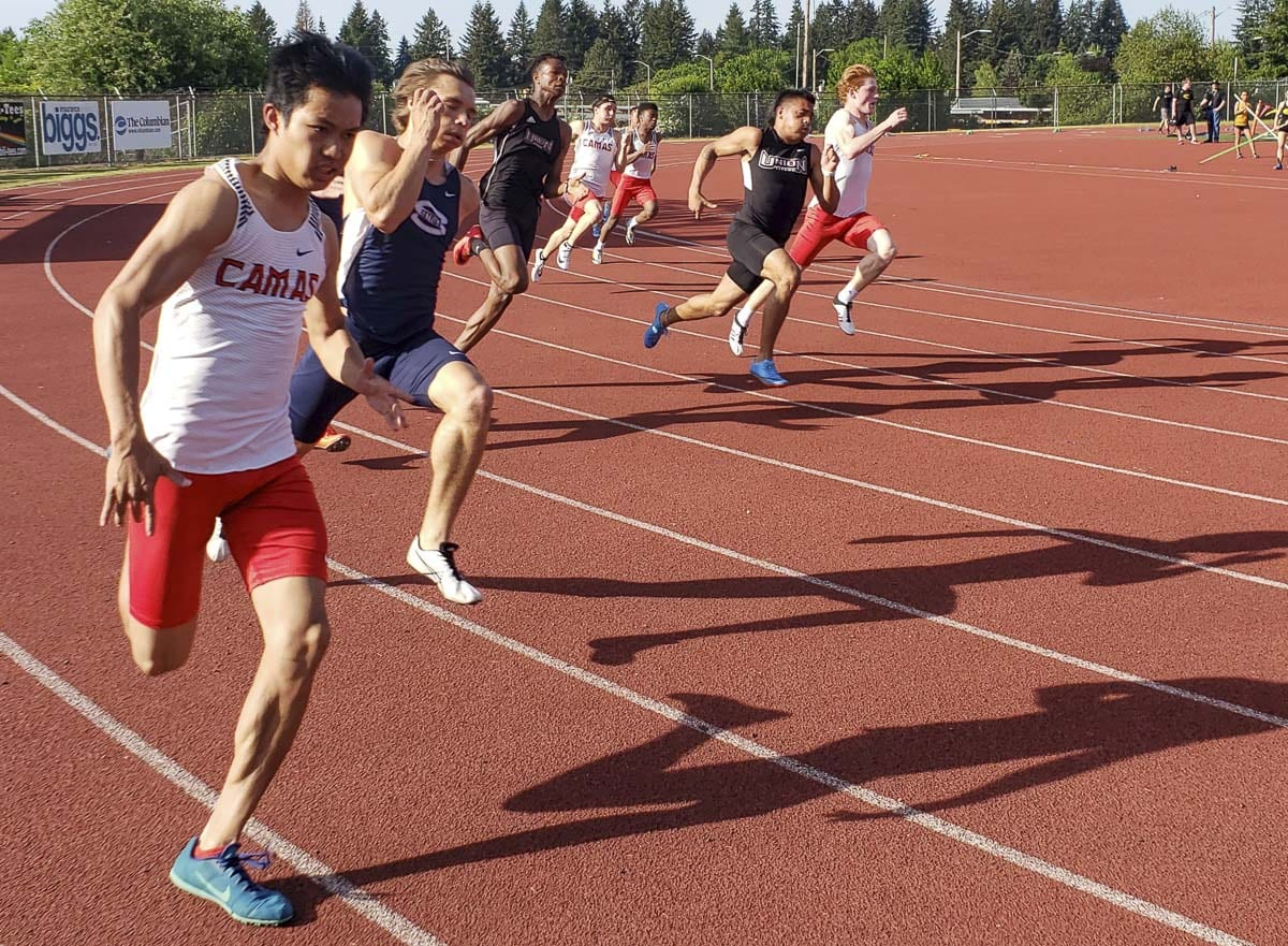 Sprinters compete in the Class 4A 200-meter dash Thursday at McKenzie Stadium. Blake Deringer of Camas would go on to win the race. Photo by Paul Valencia