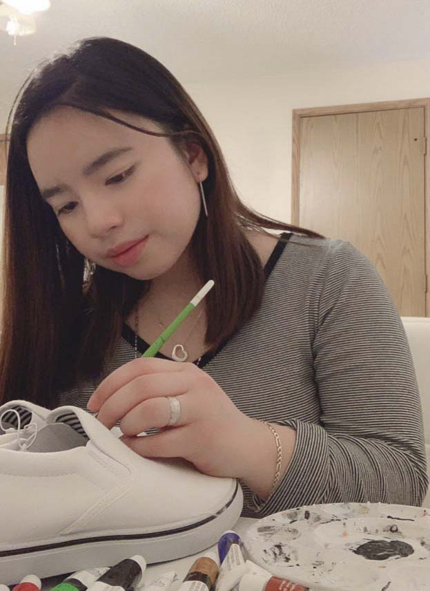 Aimee Fonacier, a senior at Mountain View, uses shoes as her canvas for her paintings. Some of her shoes will be on display at the school's fashion show Saturday night at Cascade Middle School. Photo courtesy of Aimee Fonacier
