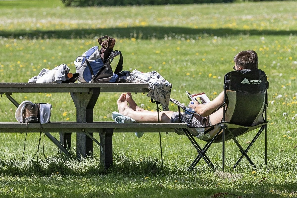 This photo from Spring 2018 shows an area resident getting some sun at Fort Vancouver. Clark County residents will have the opportunity to enjoy warm weather this weekend as temperatures are expected to rise to the high 80s and possibly 90 degrees. Photo by Mike Schultz
