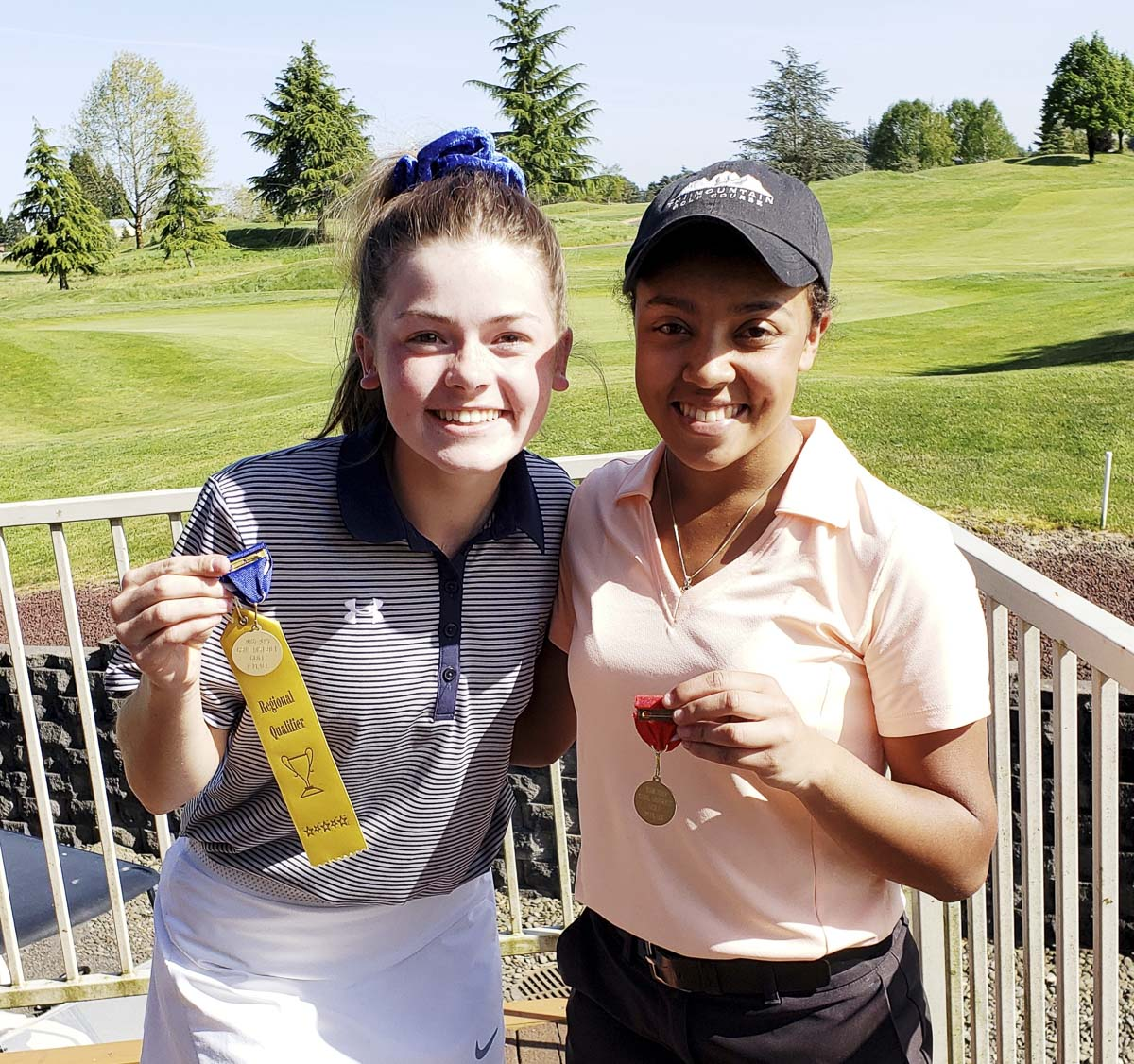 Liz Dolan of Kelso (left) and Kiana Coburn of Fort Vancouver finished first and second at the Class 3A district girls golf tournament Tuesday at Tri-Mountain Golf Course. Photo by Paul Valencia