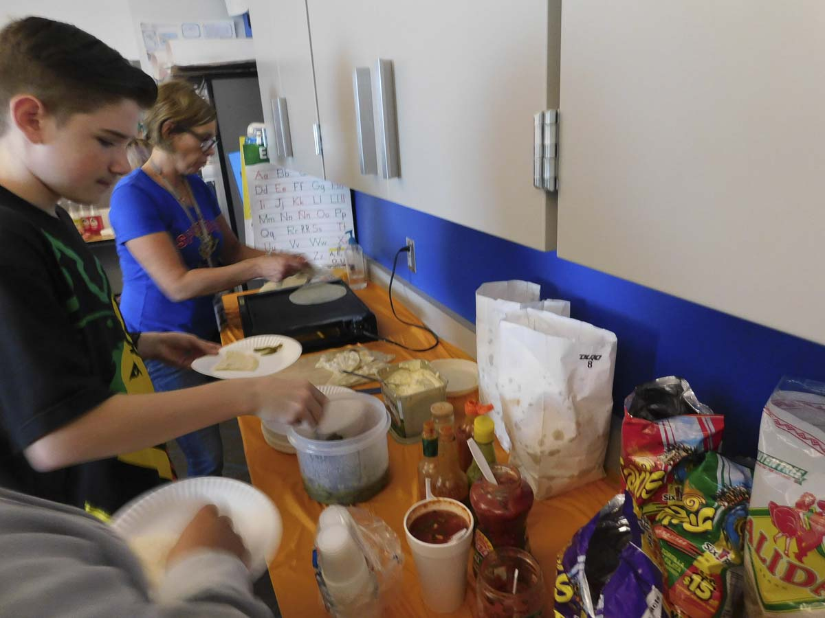 View Ridge Middle School Spanish teacher, Jennifer Zora, heats tortillas for her students during the class celebration of Mexican heritage. Photo courtesy of Ridgefield School District
