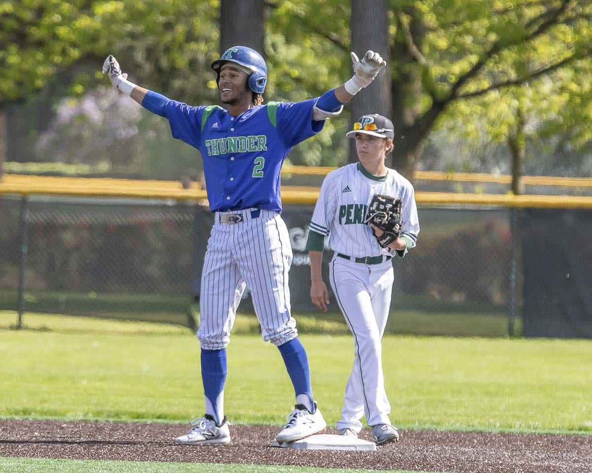 Isaiah Parker celebrates his double Saturday during Mountain View's win over Peninsula that clinched a spot in the upcoming Class 3A state baseball tournament. Photo by Mike Schultz
