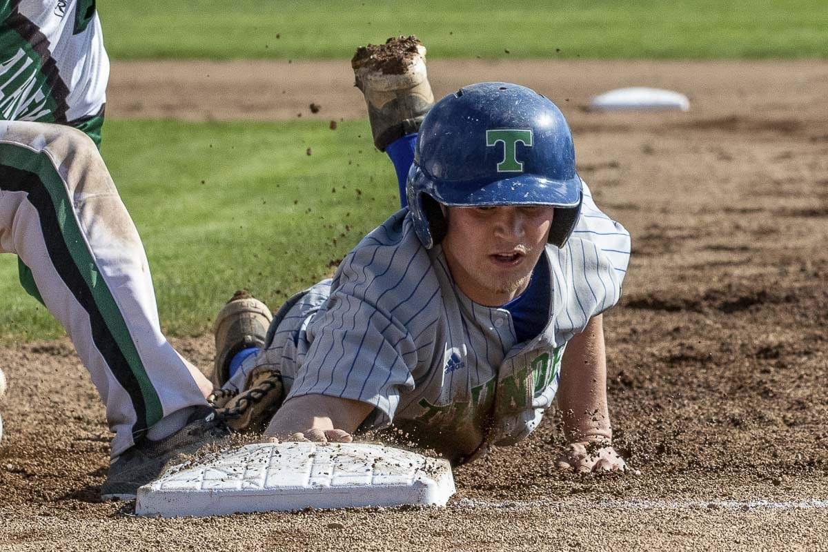Andrew Gulliford of Mountain View is back safely to the bag in a game earlier this season. Gulliford and the Thunder are hoping to qualify for the Class 3A state baseball tournament with a win Saturday in the bi-district tourney at Propstra Stadium. Photo by Mike Schultz